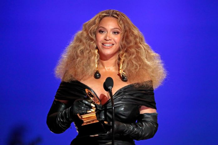Beyonce makes History winning 28 Grammys, more than any female performer, at the 63rd Grammy Awards